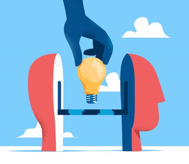 人間の頭の図にアイデアを入れる Premiumベクター