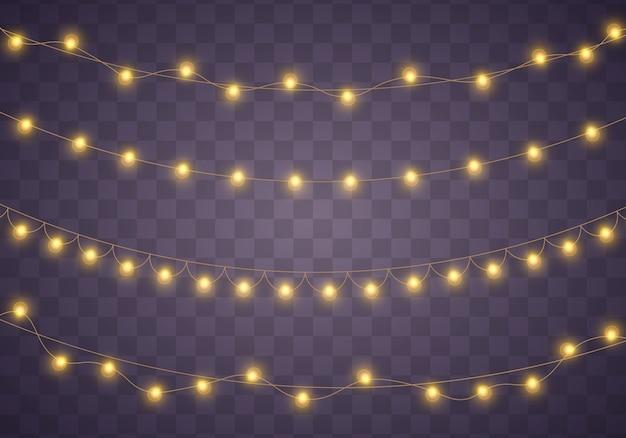 黄色のクリスマスライトは、現実的な要素を分離しました。 Premiumベクター