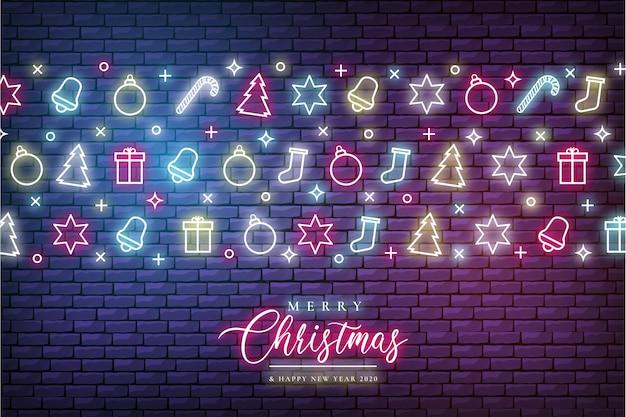ネオンの明かりでメリークリスマスの背景 無料ベクター