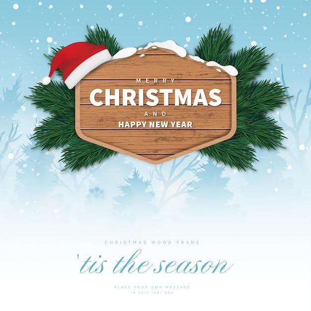 風景とモダンなメリークリスマス木製フレーム 無料ベクター