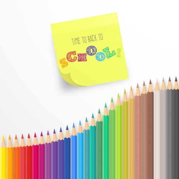 Красочный фон с карандашами и заметкой Бесплатные векторы