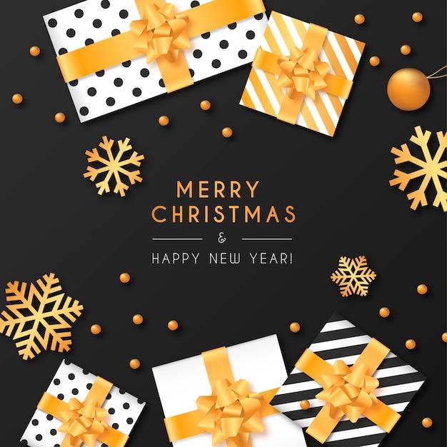 プレゼントと装飾と黒のクリスマスの背景 無料ベクター