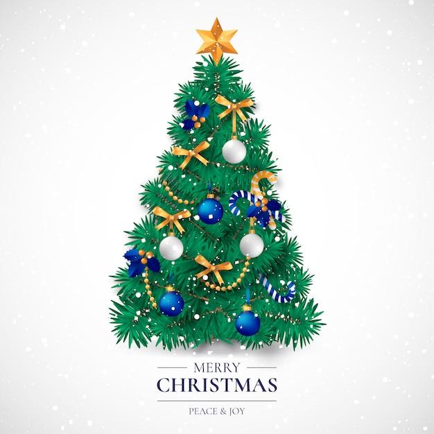 現実的な装飾の木を持つクリスマスカード 無料ベクター