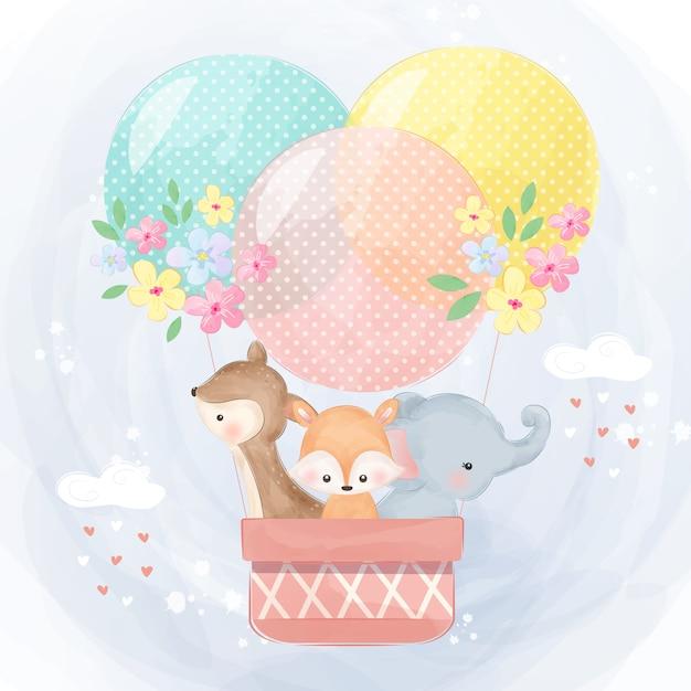 気球で飛んでいるかわいい象、トナカイ、キツネ Premiumベクター