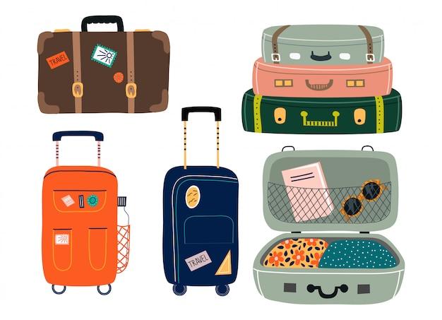 孤立したスーツケースのセット。さまざまなステッカー付きのトラベルバッグ。 Premiumベクター
