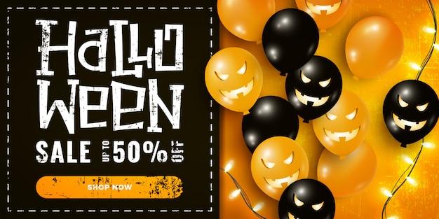 気球、暗いとオレンジのガーランドライトとハロウィーンセールプロモーションバナー Premiumベクター