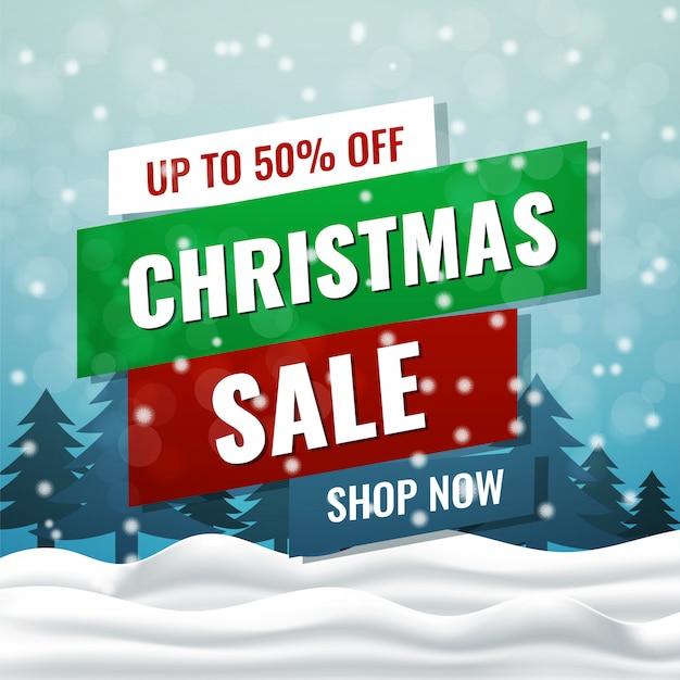 冬の風景の背景を持つクリスマスセールカード Premiumベクター