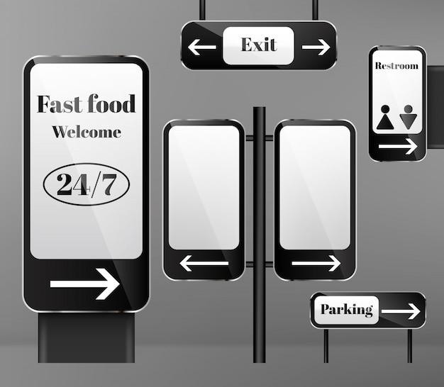 金属の柱の通りの看板のセット、背景に矢印が付いている方向の標識。 無料ベクター