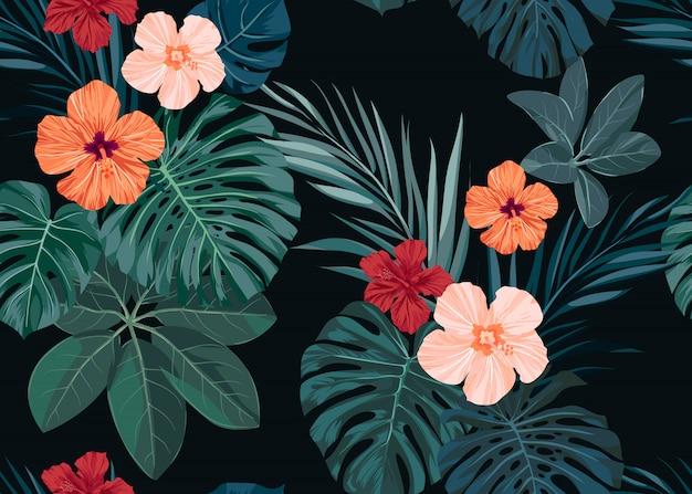 シームレスな手描き下ろし熱帯パターンハイビスカスの花とエキゾチックなヤシの葉は暗い背景に。 Premiumベクター