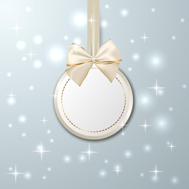 リボン付きクリスマスゴールデン吊りタグ Premiumベクター
