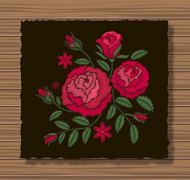 暗いフラップ布と木製のテクスチャ背景にバラと小枝の刺繍ステッチ。 Premiumベクター