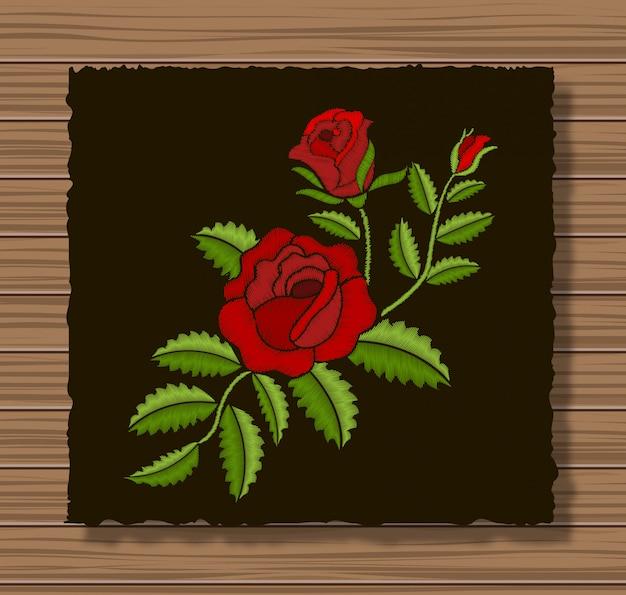 暗いフラップ布と木製のテクスチャに刺繍のバラと小枝 Premiumベクター
