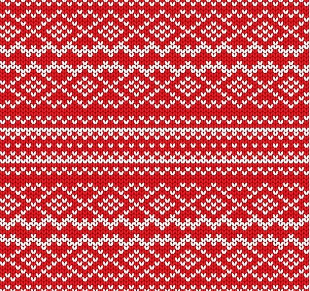 幾何学的な飾りのシームレスなパターンを編む。手作りのニットウェアのデザイン。ニット冬の赤い色のセーターのテクスチャ。 Premiumベクター