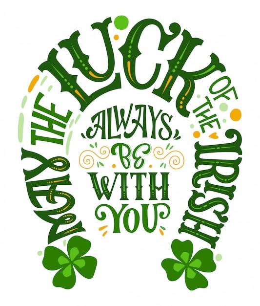 Пусть удача ирландцев всегда будет с тобой - нарисованная от руки фраза дня святого патрика, форма подковы. Premium векторы