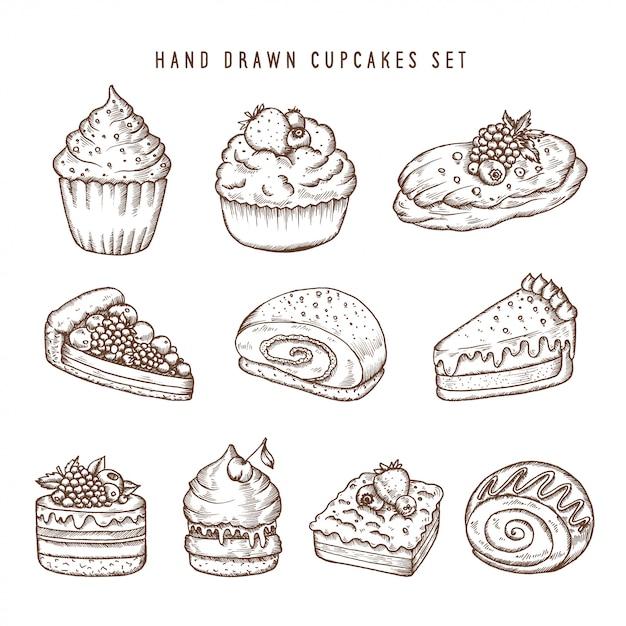 手描きのカップケーキとベーカリー製品のセット Premiumベクター