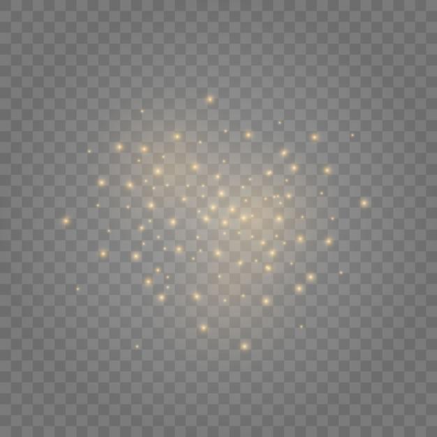 Искры пыли и золотые звезды сияют особым светом. сверкает на прозрачном фоне. сверкающие магические частицы пыли. Premium векторы