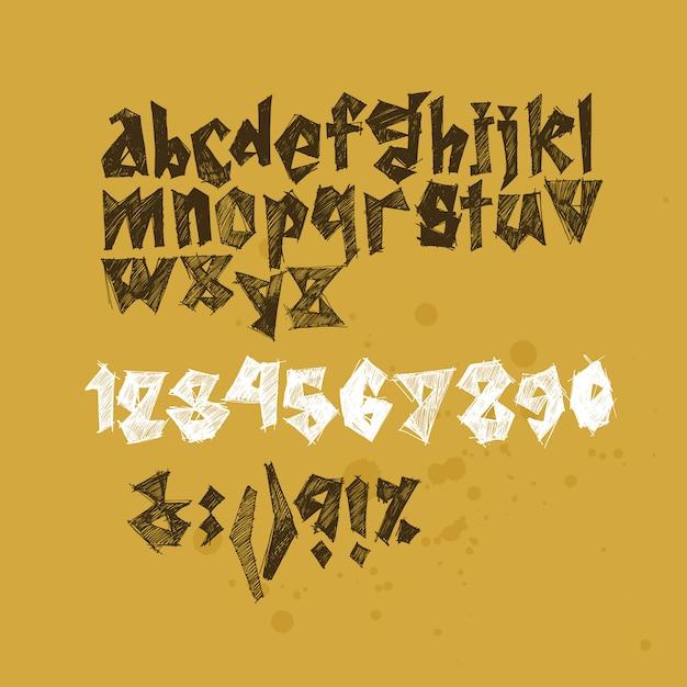 Жирный геометрический игривый шрифт с текстурой чернил. выразительные пятна. Premium векторы