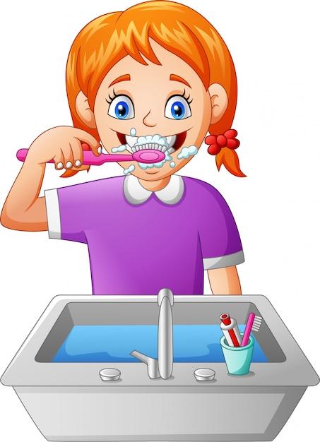 漫画の女の子の歯を磨く Premiumベクター
