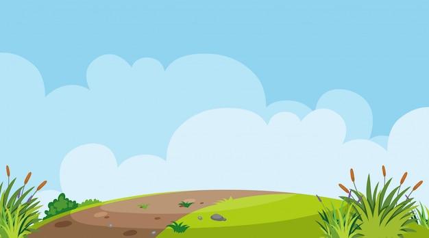 丘の上の道のある風景の背景 Premiumベクター