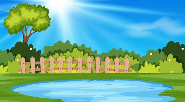 池のある公園の風景の背景 Premiumベクター