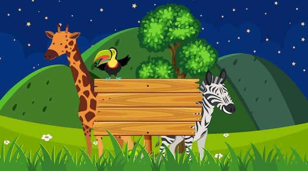 公園の背景に野生動物と枠線テンプレート Premiumベクター