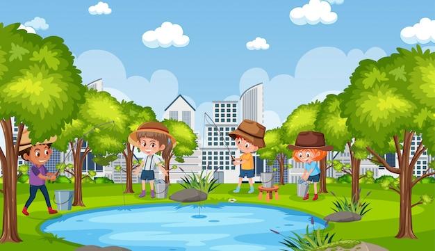 公園で釣りをしている子供たちと背景シーン Premiumベクター