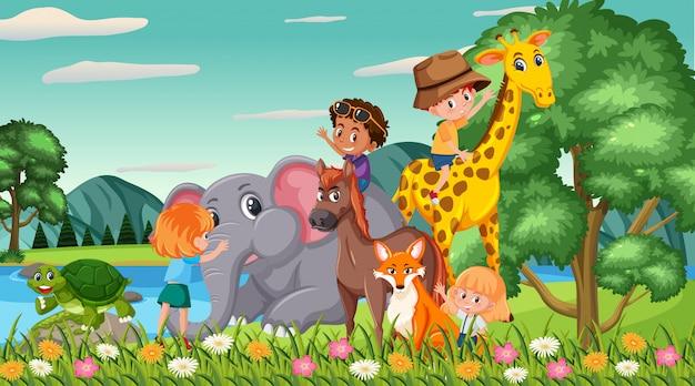 公園で幸せな子供と動物とのシーン Premiumベクター