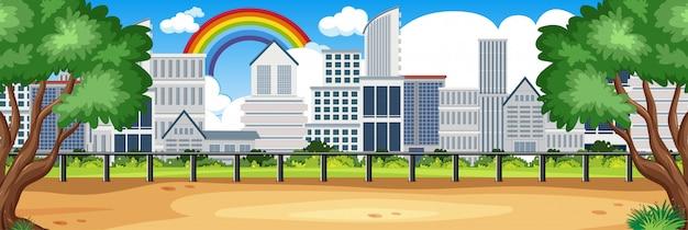 地平線自然シーンまたはシティービューと昼間の空の空に虹と風景の田園地帯 Premiumベクター