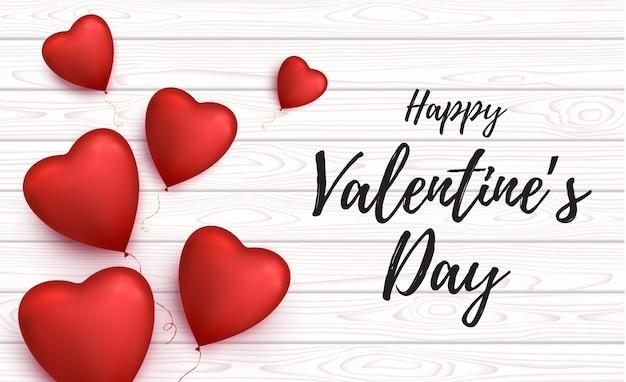 Счастливая карта дня святого валентина с воздушными шарами в форме сердца. Premium векторы