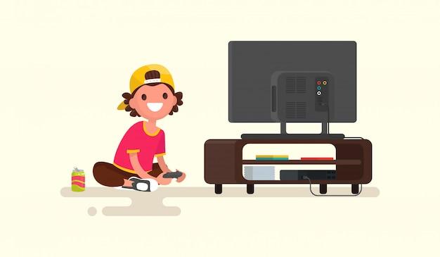 ゲームコンソールの図でビデオゲームをプレイする少年 Premiumベクター