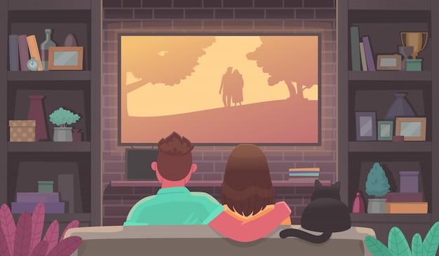 テレビを見ている若者のカップル。居心地の良い雰囲気の男女が映画を観る。家にいる。広告ストリーミングサービスまたはオンライン映画。 Premiumベクター