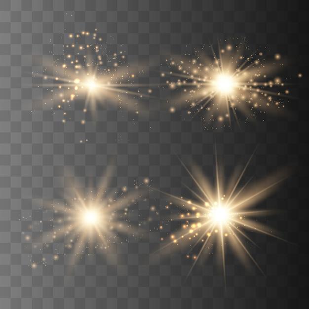 Набор золотых искр изолированы. вектор светящиеся звезды Premium векторы