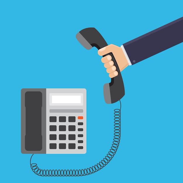 Рука бизнесмена держа иллюстрацию телефона офиса плоскую Premium векторы