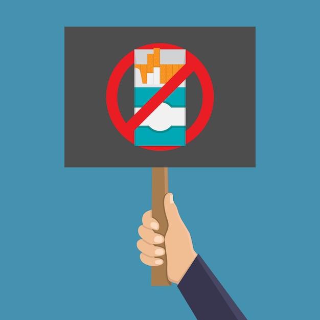 喫煙を停止する看板を持っている手 Premiumベクター