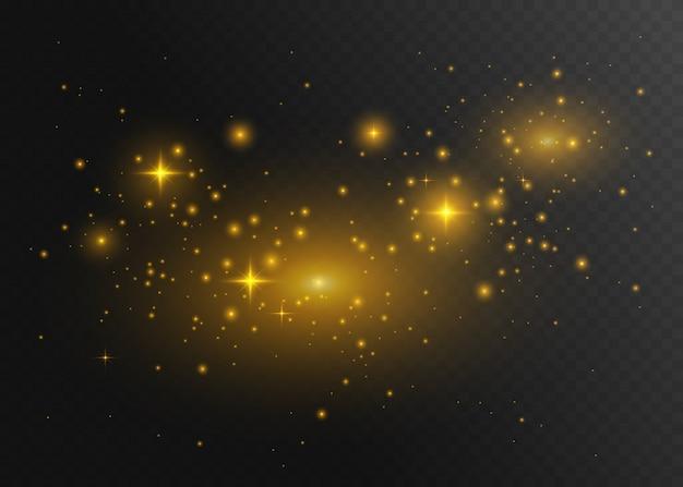 ダストゴールド。白い火花と金色の星が特別な光で輝いています。 Premiumベクター
