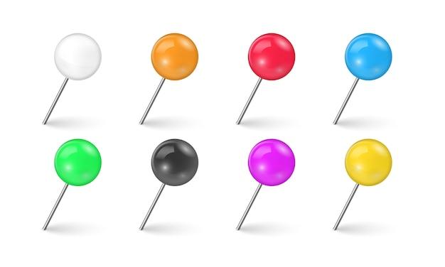 Швейные иглы или пластиковые кнопки для заметок на бумаге. комплект красочного тэкса штыря в различном ракурсе изолированного на белой предпосылке. реалистичные кнопки. Premium векторы