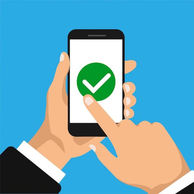 手は、スマートフォンと指のタッチスクリーンを保持しています。スマートフォン画面のチェックボックス。リストの概念を行うには。ビジネスマンはボタンを受け入れ、それをクリックします。 Premiumベクター