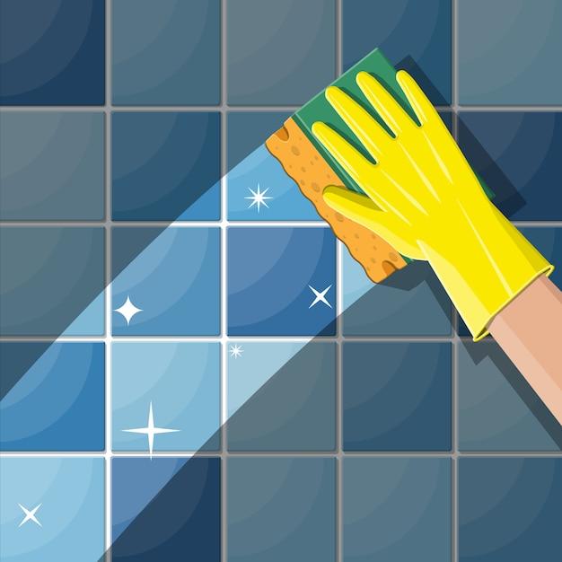 Рука в перчатках с губкой для мытья стен Premium векторы