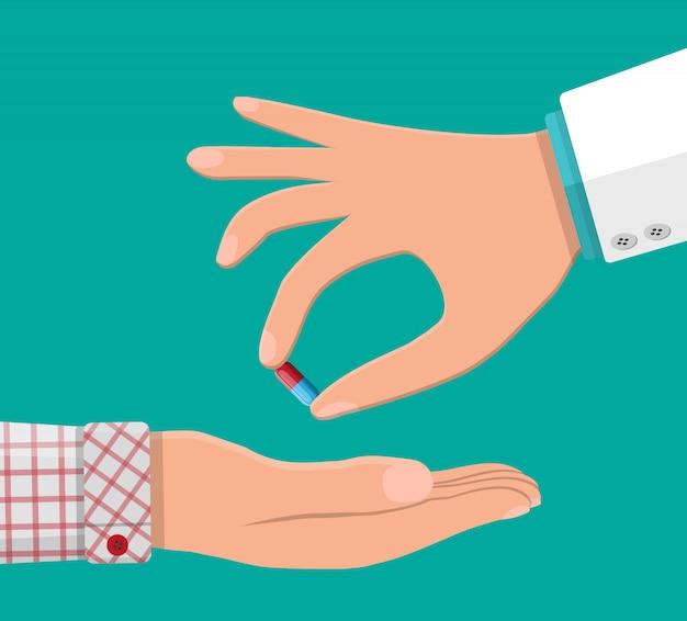 Рука доктора дает капсулу пациенту. Premium векторы