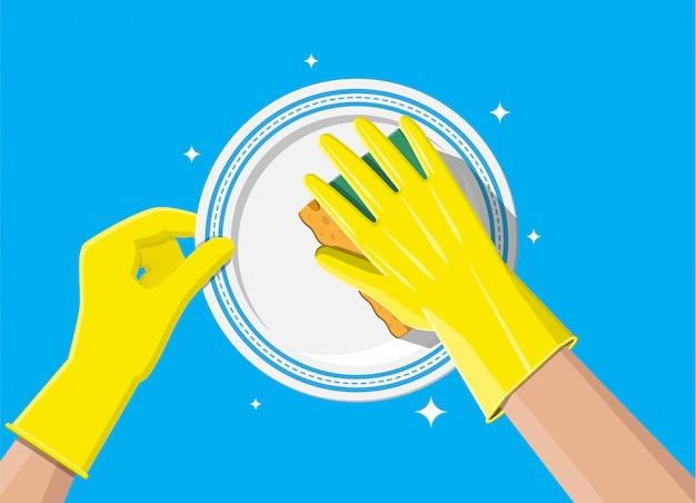 Рука в перчатках с губкой для мытья посуды Premium векторы
