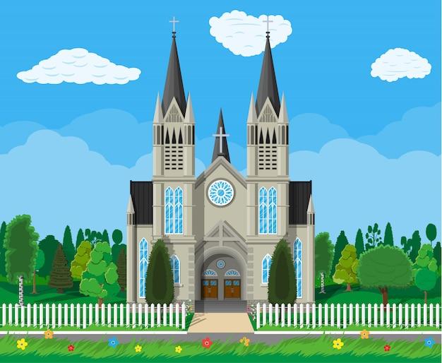 Католическая церковь собор с деревьями и забором Premium векторы