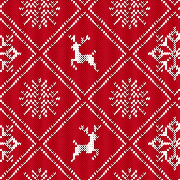 クリスマスは、ムースと雪の結晶の幾何学的な飾りを編んだ。ニットのシームレスな背景。ニット柄 Premiumベクター