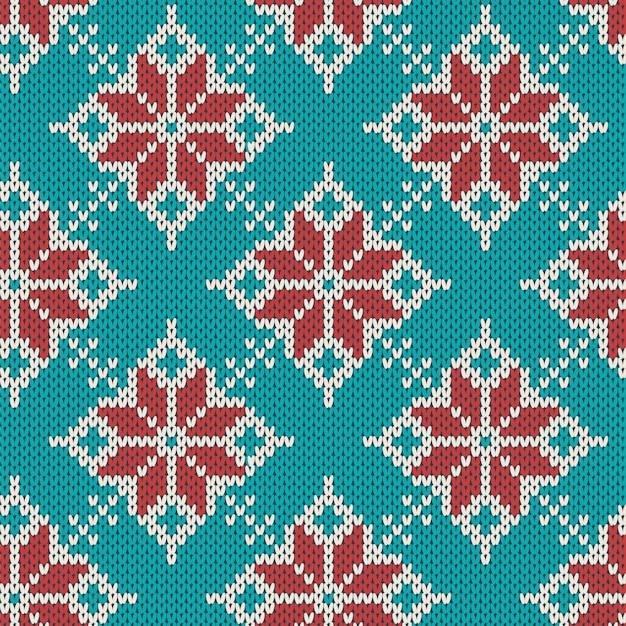 クリスマスは、幾何学的な雪のシームレスなパターンを編みます。ニットの青いセーター。 Premiumベクター