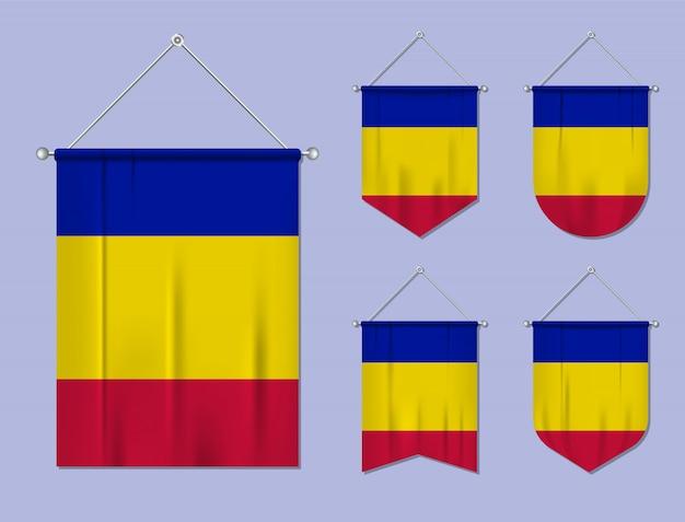 Набор флагов андорры с текстильной текстурой. разнообразие форм национального флага страны. вертикальный шаблон вымпела. Premium векторы