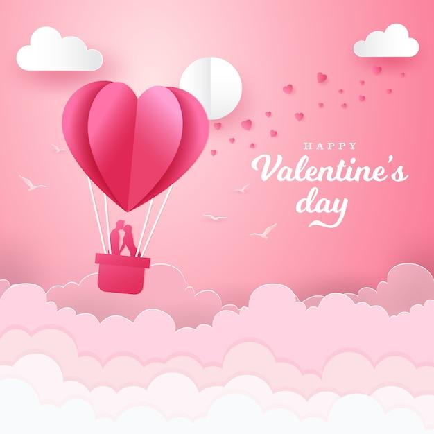 ロマンチックなカップルがキスし、気球のバスケットの中に立っているとバレンタインデーの背景。紙カットスタイルのベクトル図 Premiumベクター