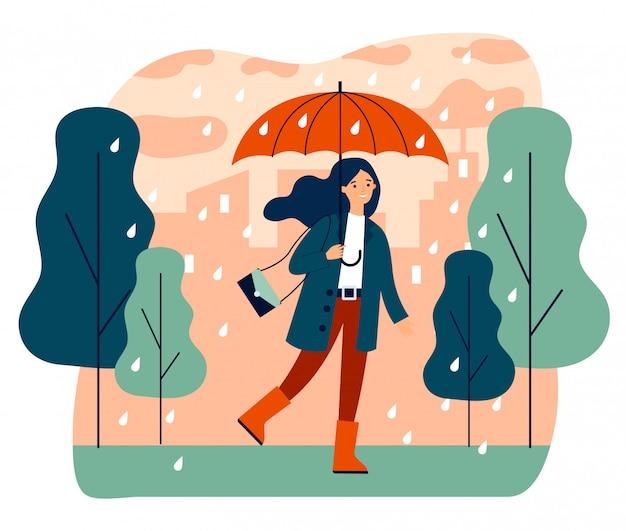 Счастливая улыбающаяся девочка с зонтиком гуляет в дождливый день Premium векторы