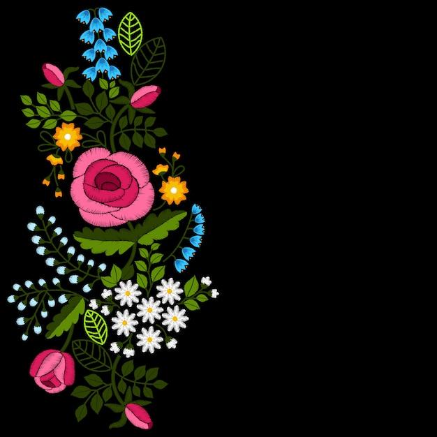 黒い背景に野の花とバラの刺繍。 Premiumベクター