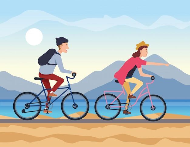若いカップルが自転車で旅行します。 Premiumベクター