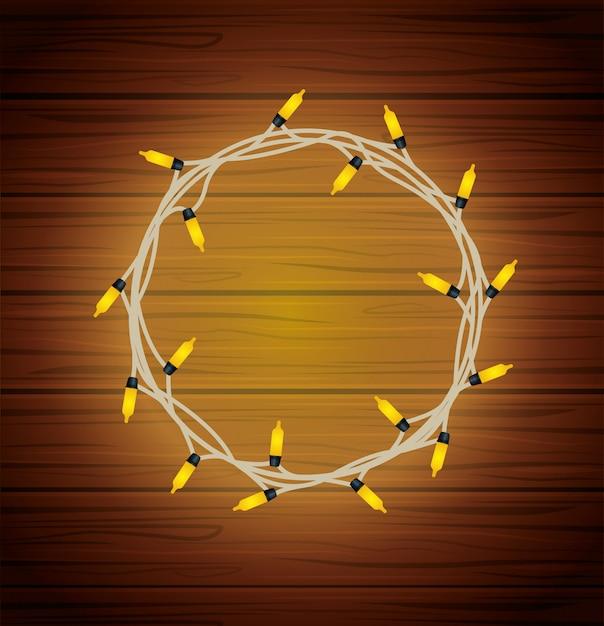 Счастливого рождества круглая рамка лампочки на дереве Premium векторы