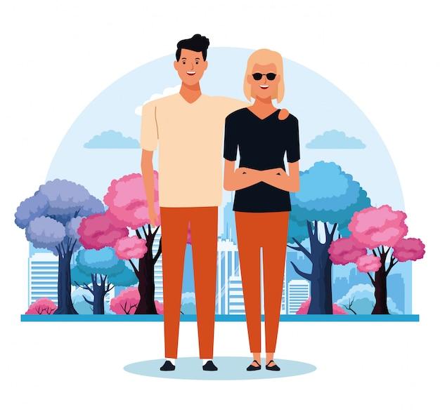 カラフルな木の上に立っている漫画若いカップル Premiumベクター